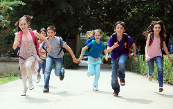 Classmate pupils running outside.
